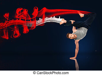Martial arts expert doing hand stand with red smoke and...