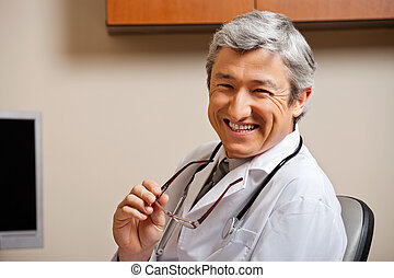 Happy Male Doctor - Portrait of a jovial mature male doctor...