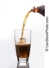 Soda pouring into glass on white background