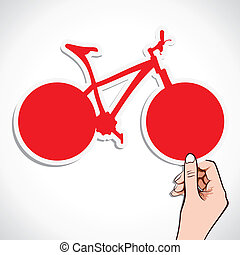 red bicycle sticker in hand