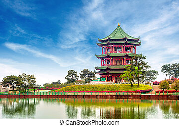 Chinese ancient buildings: garden. - Blue sky and white...