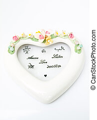 A white ceramic hearth with various language meaning of love iso