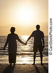 Senior Couple Holding Hands Sunset Tropical Beach - Senior...