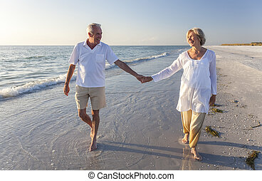 Happy Senior Couple Walking Holding Hands Tropical Beach -...