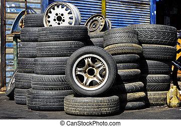 Stacks of old used tires in front of the auto service...