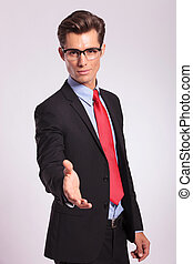 business man offering handshake - cutout picture of a young...