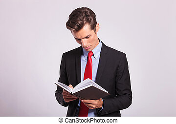 young business man reading book
