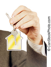 Keys with keychain in the form of a house in a male arm