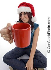 sitting woman showing coffee mug on an isolated white...