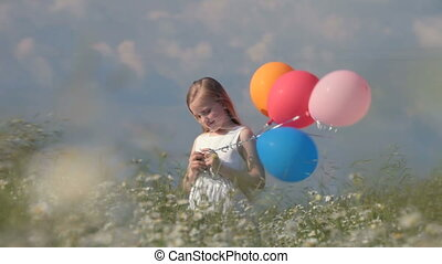 Little girl with balloons in spring - Little blonde girl...