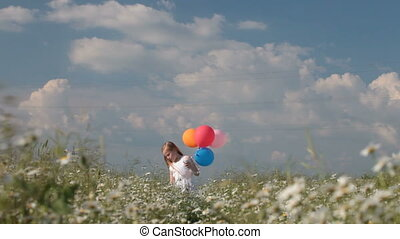 Child with balloons - little blonde girl with colorful...