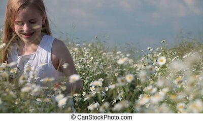 Child picking flowers for mother on spring blossoming meadow