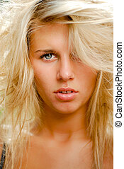 Young beautiful blond woman with back combing hairstyle