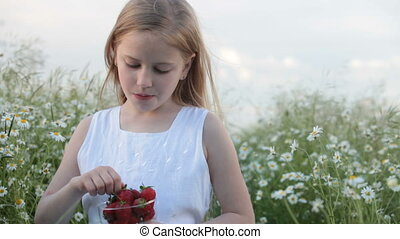 Child eating strawberries - Little girl eating strawberries