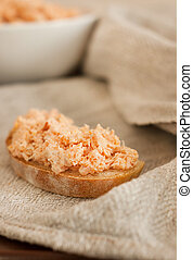 Trout pate (rillettes) and rustic bread, selective focus