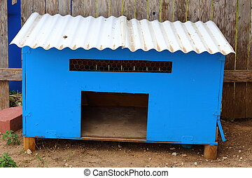 Chicken Coop - A chicken coop with white corrugated roof and...