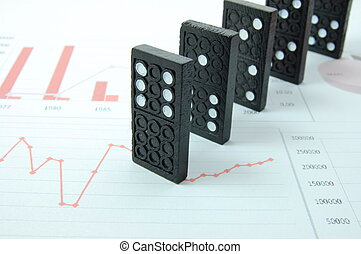 risky domino over a financial business chart - domino over...