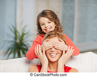 mother and daughter making a joke or playing hide and seek