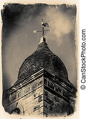 Church wind vane - A golden wind vane above a church in the...