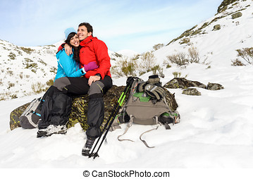 Happy couple winter hiking