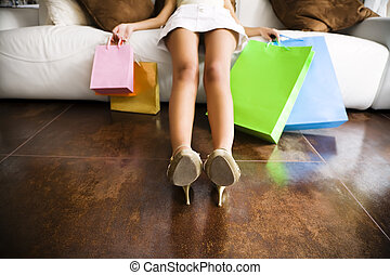 shopping - Woman relaxing on couch after long day shopping