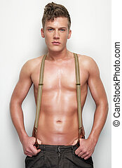 Handsome Man Undressed with Suspenders - Portrait of a...