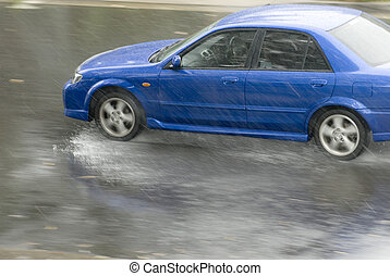 rainstorm - driving in dangerous conditions on a wet road