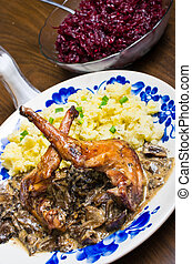 Rabbit in mushroom sauce with beetroots and potato puree