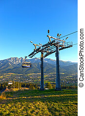 Chairlift on a mountain in the Tatras, Poland.