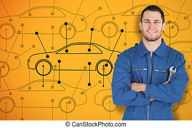 Young smiling mechanic standing in front of cars background...