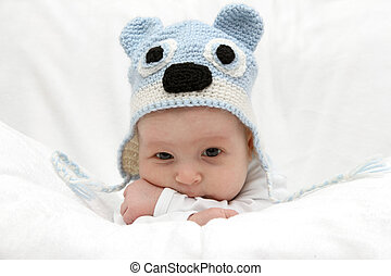 Beautiful baby in hat - Beautiful baby in blue hat on the...