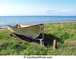 Beach landscape -Skiff boat on the sand - Beach landscape -...
