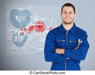 Portrait of a young mechanic next to futuristic interface...