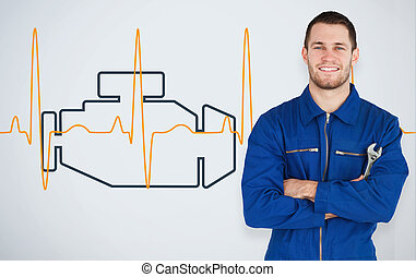 Portrait of a smiling young mechanic next to background with...