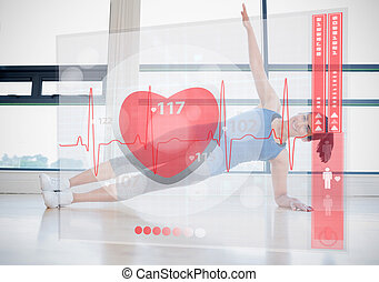 Young woman doing yoga while looking at futuristic interface...