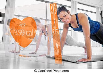 Women using interface at the gym - Women using modern orange...