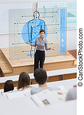 Standing teacher in front of futuristic interface asking a question to students