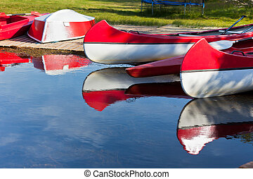 Red and White Canoes and Boats