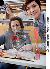 Teacher and student looking futuristic interface during...