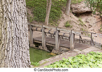 Wooden bridge in Sofiyivsky park - Uman, Ukraine - Old...