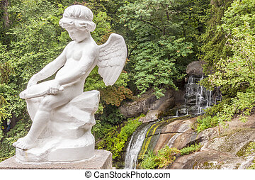 Angel figure in Sofiyivsky park - Uman, Ukraine - Figure of...