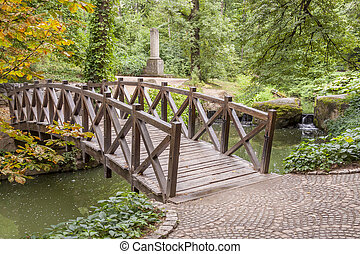 Wooden bridge in Sofiyivsky park - Uman, Ukraine - Colourful...
