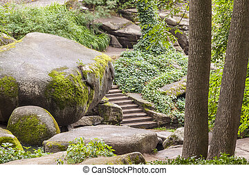 Stairs and big stone in Sofiyivsky park - Uman, Ukraine. -...