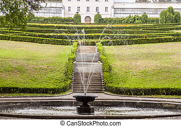 Small fountain in background hedgerow - Uman, Ukraine -...