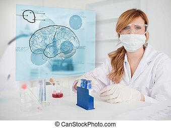 Chemist working in protective suit with futuristic interface...