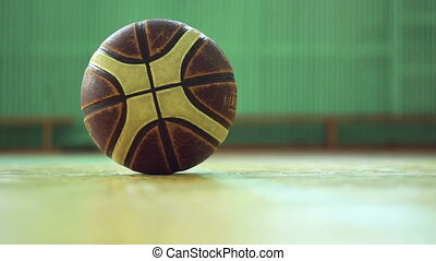 man picking up ball from the floor