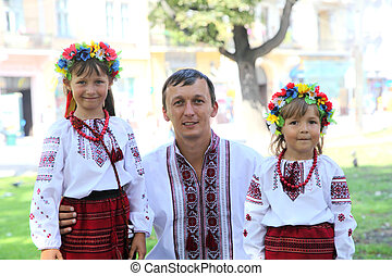 Ukrainian national costumes - Father with a small daughter...