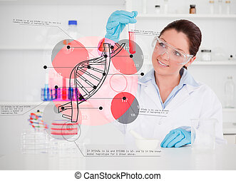 Smiling scientist examining test tube with dna helix...