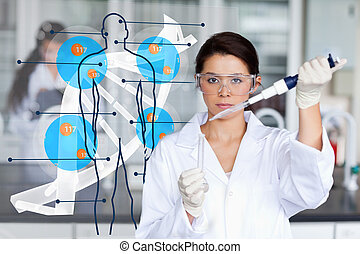 Serious chemist working with human dna interface in the lab