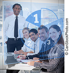 Smiling business people using blue